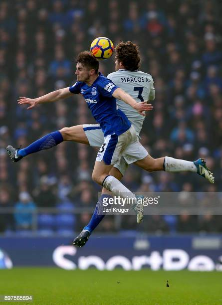 Jonjoe Kenny of Everton and Marcos Alonso of Chelsea compete for a header during the Premier League match between Everton and Chelsea at Goodison...