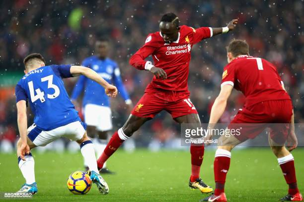 Jonjoe Kenny of Everton and Sadio Mane of Liverpool battle for the ball during the Premier League match between Liverpool and Everton at Anfield on...