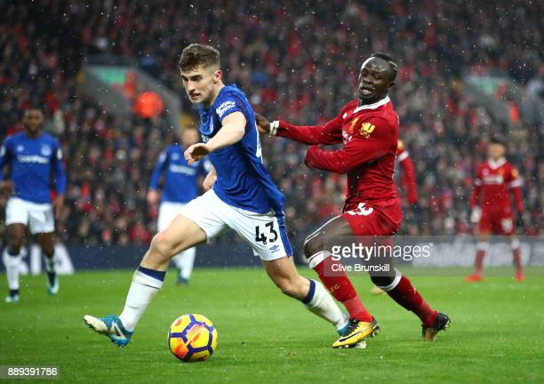 Jonjoe Kenny of Everton and Sadio Mane of Liverpool battle for possesion during the Premier League match between Liverpool and Everton at Anfield on...