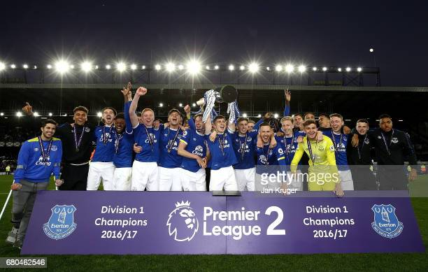 Jonjoe Kenny of Everton lifts the trophy and celebrates winning the league with team mates during the Premier League 2 match between Everton and...
