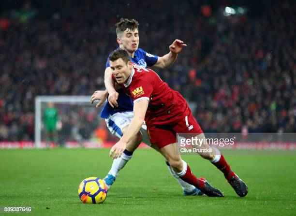 Jonjoe Kenny of Everton tackles James Milner of Liverpool during the Premier League match between Liverpool and Everton at Anfield on December 10...