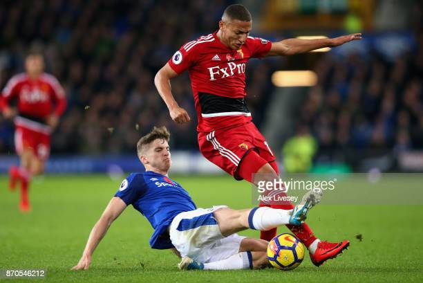 Jonjoe Kenny of Everton tackles Richarlison de Andrade of Watford during the Premier League match between Everton and Watford at Goodison Park on...