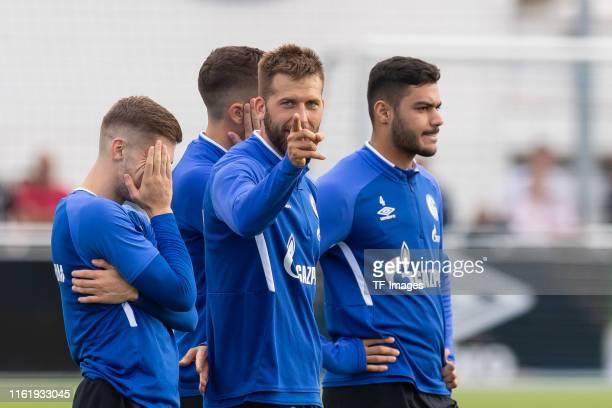 Jonjoe Kenny of FC Schalke 04 Guido Burgstaller of FC Schalke 04 and Ozan Kabak of FC Schalke 04 look on during the Schalke 04 Training Session on...