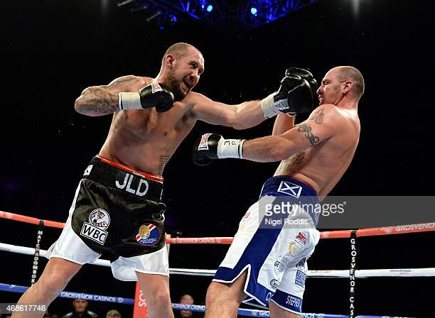 JonLewis Dickinson of England in action with Stephen Simmons of Scotland during their WBC International Silver Cruiserweight Championship boxing...