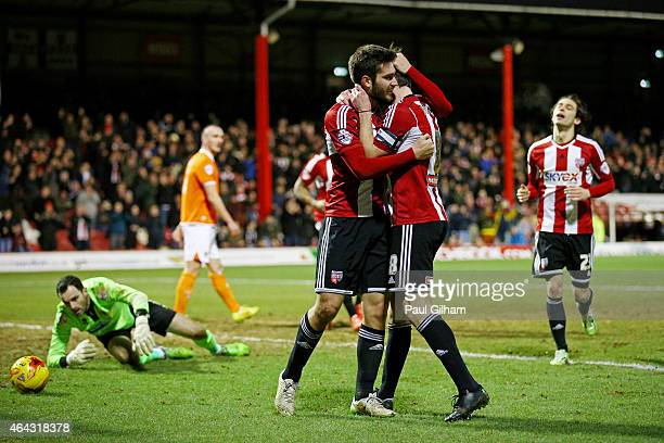 JonMiquel Toral of Brentford is congratulated by teammate Jonathan Douglas of Brentford after scoring the opening goal during the Sky Bet...