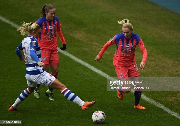 Jonna Andersson of Chelsea is challenged by Kristine Leine of Reading during the Barclays FA Women's Super League match between Reading Women and...