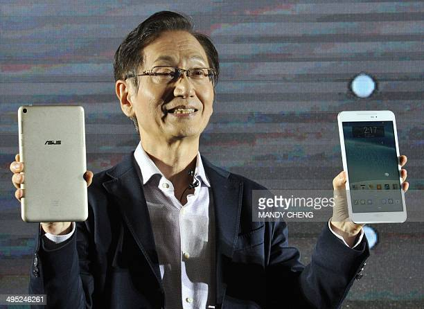 Jonney Shih the chairman of Taiwanese electronics company ASUS introduces the company's new 'ASUS Fonepad' during a press conference ahead of the...