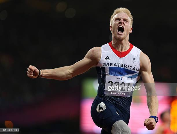 Jonnie Peacock of Great Britain celebrates winning gold in the Men's 100m T44 Final on day 8 of the London 2012 Paralympic Games at Olympic Stadium...