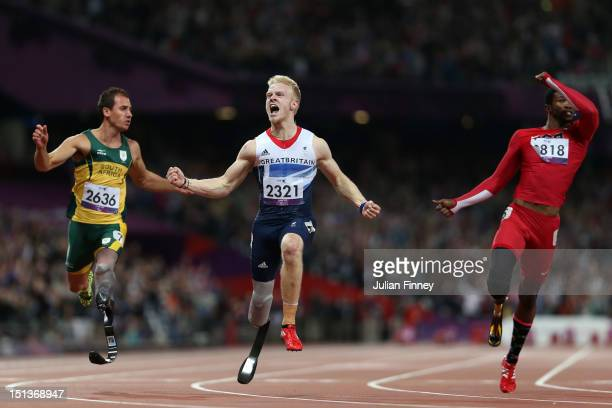 Jonnie Peacock of Great Britain crosses the line to win gold in the Men's 100m T44 Final on day 8 of the London 2012 Paralympic Games at Olympic...