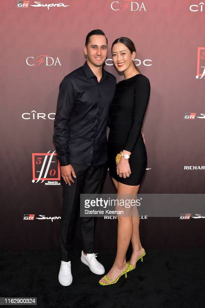Jonnie West and Michelle Wie attend Sports Illustrated Fashionable 50 2019 at Sunset Room Hollywood on July 18 2019 in Hollywood California