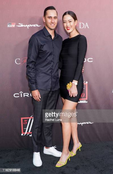 Jonnie West and Michelle Wie attend Sports Illustrated Fashionable 50 at The Sunset Room on July 18 2019 in Los Angeles California
