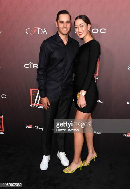 Jonnie West and Michelle Wie attends the Sports Illustrated Fashionable 50 at The Sunset Room on July 18 2019 in Los Angeles California