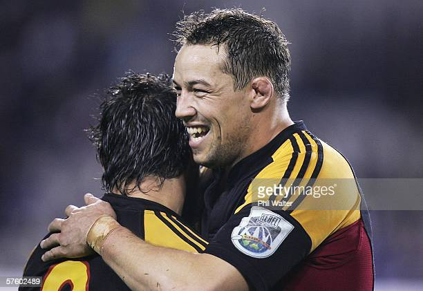 Jonno Gibbes of the Chiefs hugs Byron Kelleher following the round fourteen Super 14 match between the Blues and the Chiefs at Eden Park May 13 2006...