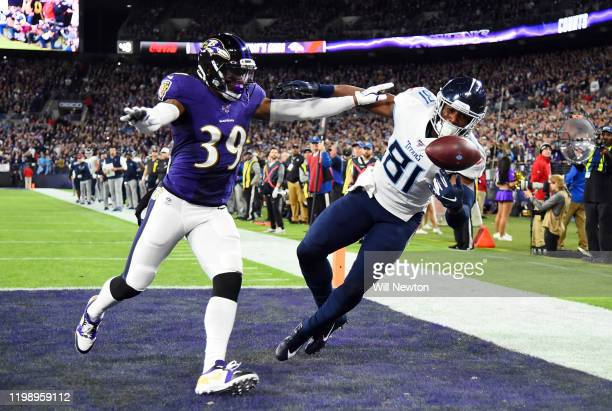 Jonnu Smith of the Tennessee Titans catches a touchdown over Brandon Carr of the Baltimore Ravens in the first quarter of the AFC Divisional Playoff...