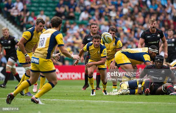 Jonny Arr of Worcester Warriors passes to Ryan Lamb during the Aviva Premiership match between Saracens and Worcester Warriors at Twickenham Stadium...