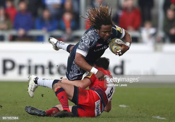 Jonny Arr of Worcester Warriors tackles Marland Yarde of Sale Sharks during the Aviva Premiership match between Sale Sharks and Worcester Warriors at...