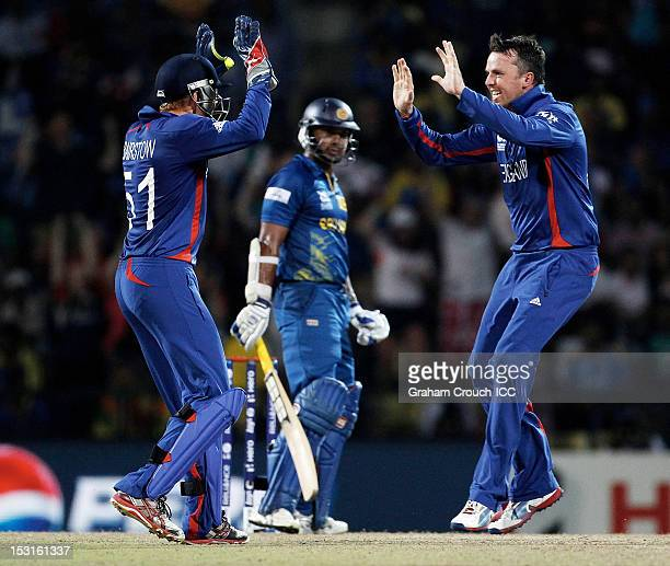 Jonny Bairstow and Graeme Swann of England celebrate after dismissing Kumar Sangakkara of Sri Lanka during the Super Eights Group 1 match between...