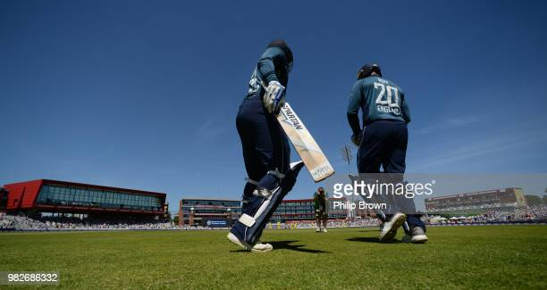 Jonny Bairstow and Jason Roy of England go on to the field during the fifth Royal London OneDay International match between England and Australia at...