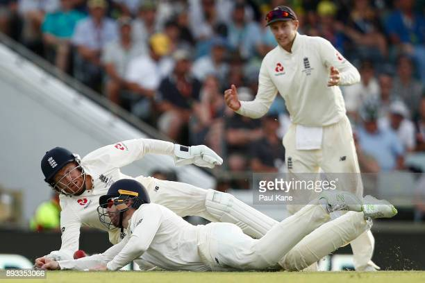Jonny Bairstow and Mark Stoneman of England dive for a catch off Shaun Marsh of Australia during day two of the Third Test match during the 2017/18...