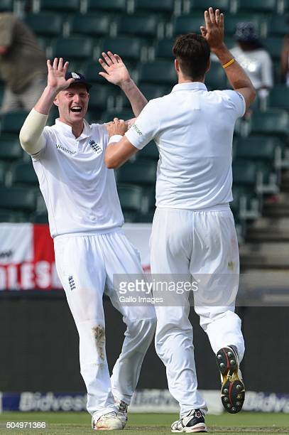 Jonny Bairstow and Steven Finn of England celebrate the wicket of Faf du Plessis of the Proteas during day 1 of the 3rd Test match between South...