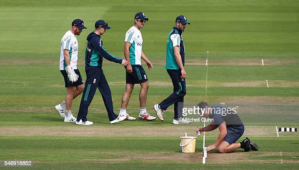 Jonny Bairstow Joe Root Alastair Cook and James Vince watches as a groundsman prepares the wicket during England nets session ahead of the 1st...