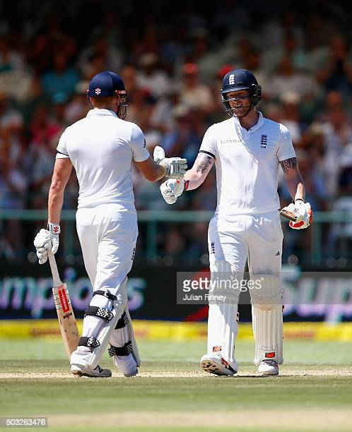 Jonny Bairstow of England and Ben Stokes of England support each other in their partnership during day two of the 2nd Test at Newlands Stadium on...