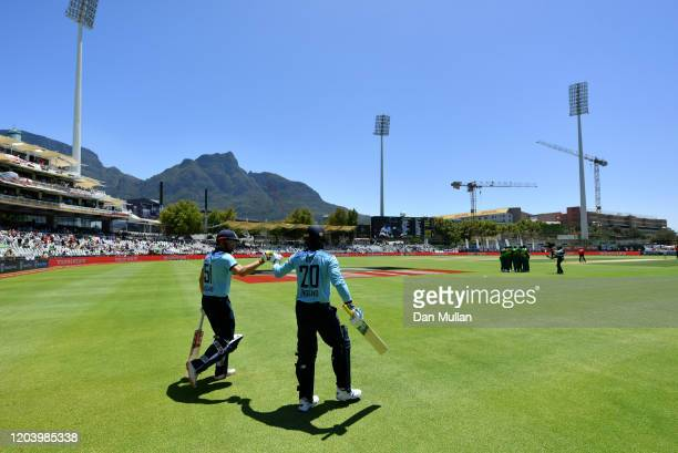 Jonny Bairstow of England and Jason Roy of England walk out to bat during the First One Day International match between South Africa and England at...