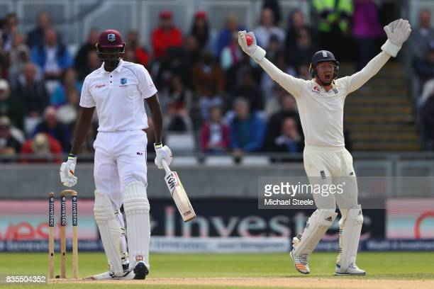 Jonny Bairstow of England appeals successfully for the wicket of Jason Holder of West Indies off the bowling of Moeen Ali during day three of the 1st...