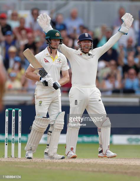 Jonny Bairstow of England celebrates after Moeen Ali of England claimed the wicket of Cameron Bancroft of Australia during day three of the 1st...