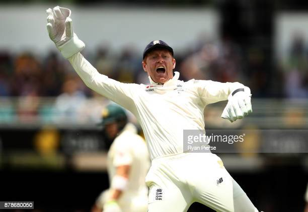 Jonny Bairstow of England celebrates after taking a catch to dismiss Tim Paine of Australia off the bowling James Anderson of England during day...