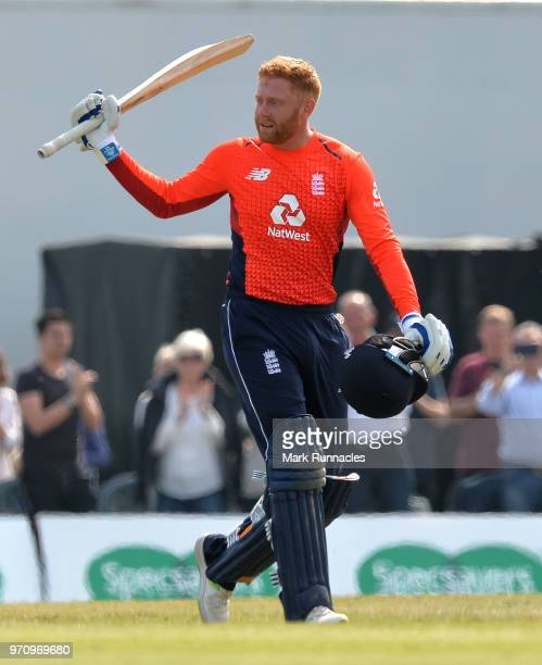 Jonny Bairstow of England celebrates reaching 100 runs during the One Day International match between Scotland and England at The Grange on June 10...