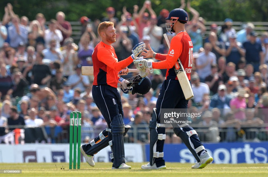 Jonny Bairstow of England celebrates reaching 100 runs with team mate Alex Hales during the One Day International match between Scotland and England at The Grange on June 10, 2018 in Edinburgh, Scotland.