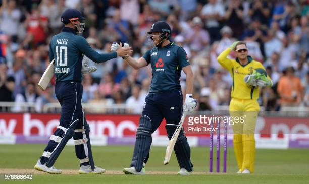 Jonny Bairstow of England celebrates reaching his century with Alex Hales during the third Royal London OneDay International match between England...