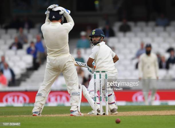 Jonny Bairstow of England has his head in his hands as Rishabh Pant of India edges the ball past the stumps during the Specsavers 5th Test Day Five...