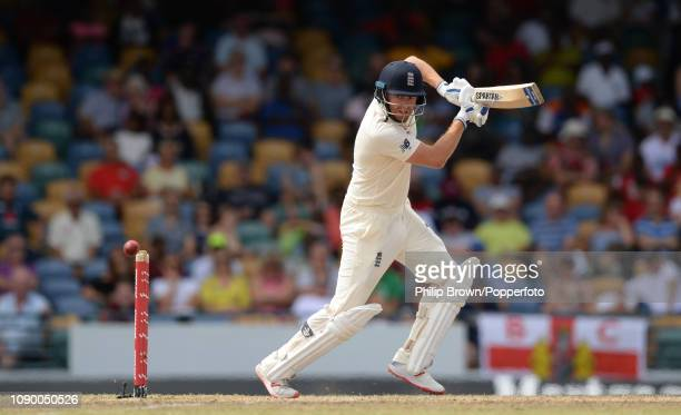 Jonny Bairstow of England hits out during the fourth day of the first Test match between the West Indies and England at Kensington Oval on January 26...