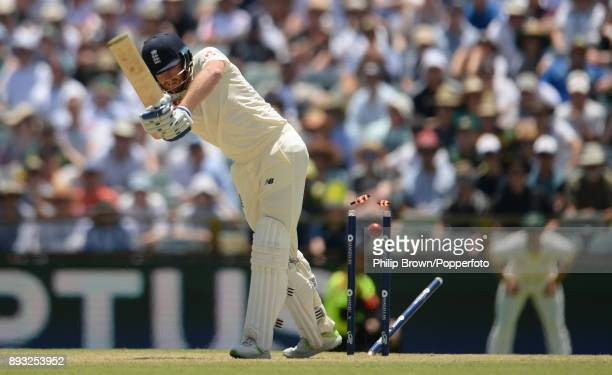 Jonny Bairstow of England is bowled during the second day of the third Ashes cricket test match between Australia and England at the WACA on December...