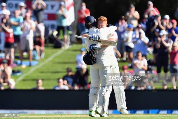 Jonny Bairstow of England is congratulated by Jack Leach of England after scoring a century during day two of the Second Test match between New...