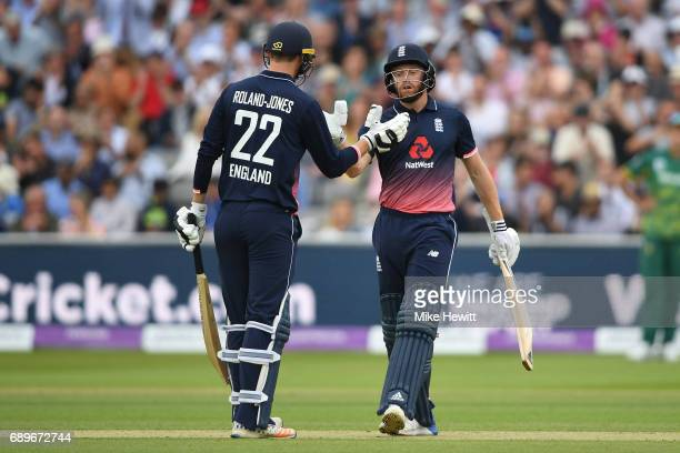 Jonny Bairstow of England is congratulated by Toby RolandJones after reaching 50 during the 3rd Royal London ODI between England and South Africa at...