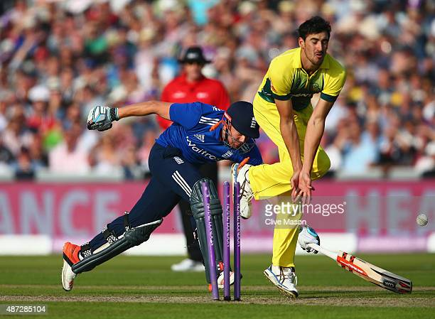Jonny Bairstow of England is run out as Mitchell Starc of Australia takes evasive action during the 3rd Royal London OneDay International match...