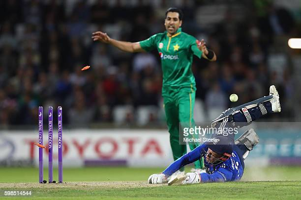 Jonny Bairstow of England is run out from a direct hit by Azhar Ali during the 4th Royal London One Day International match between England and...