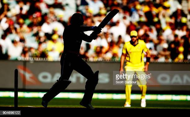 Jonny Bairstow of England is silhouetted as he bats during game one of the One Day International Series between Australia and England at Melbourne...