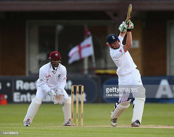 Jonny Bairstow of England Lions in action on his way to a half century watched by Denesh Ramdin of West Indies during day two of the tour match...