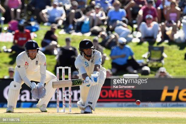 Jonny Bairstow of England looks on as Ross Taylor of New Zealand bats during day five of the Second Test match between New Zealand and England at...