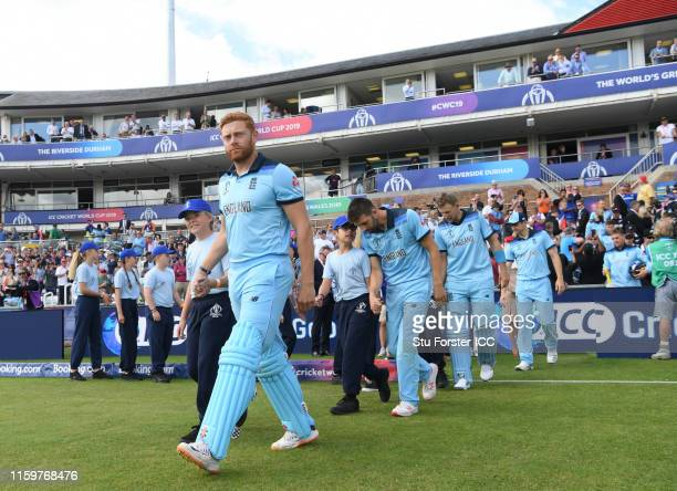 Jonny Bairstow of England makes his way out for the national anthems during the Group Stage match of the ICC Cricket World Cup 2019 between England...
