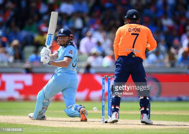 Jonny Bairstow of England on his way to a century as MS Dhoni of India looks on during the Group Stage match of the ICC Cricket World Cup 2019...