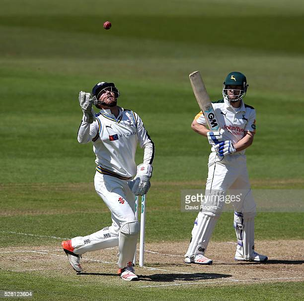 Jonny Bairstow of Yorkshire catches the ball as Chris Read looks on during the Specsavers County Championship division one match between...