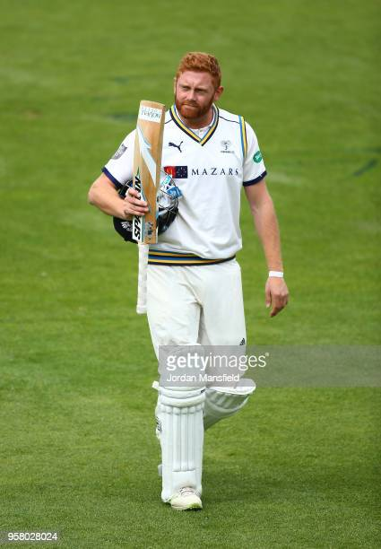 Jonny Bairstow of Yorkshire makes his way off the field after being dismissed by Jade Dernbach of Surrey during day three of the Specsavers County...