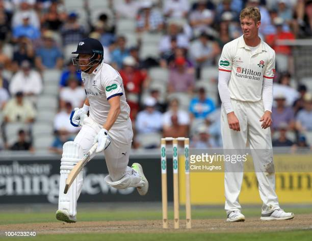Jonny Bairstow of Yorkshire runs a single to reach his half century as Lancashire's Keaton Jennings looks on during day two of the Specsavers County...
