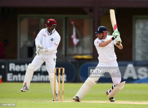 Jonny Bairstowl of England Lions in action on his way to a half century watched by Denesh Ramdin of West Indies during day two of the tour match...