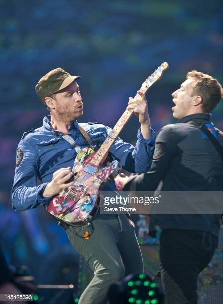 Jonny Buckland and Chris Martin of Coldplay perform on stage at Ricoh Arena on May 29, 2012 in Coventry, United Kingdom.